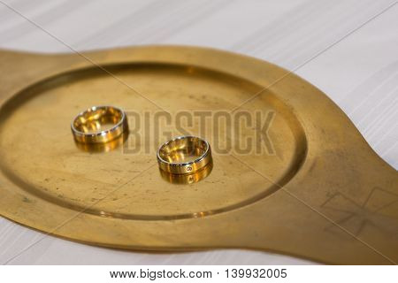 Two gold wedding rings on Gold Tablet