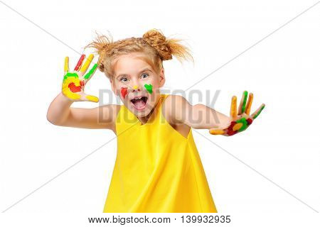 Cute little girl with painted colorful hands. Happy childhood. Isolated over white.
