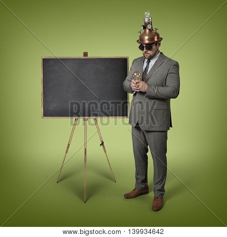 Science businessman with empty blackboard - studio shot