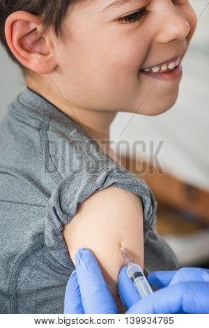 Cheerful Boy Receives A Vaccination