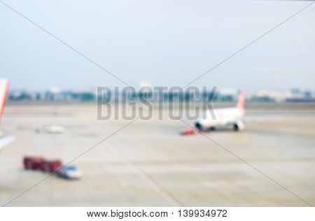 Blurred Background : Looking Through Terminal Window To See Airplane At Airport