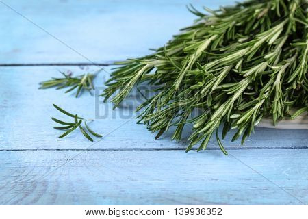 Fresh rosemary on wooden table