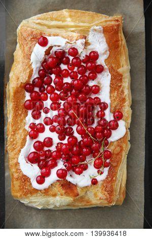 Fresh berry dessert on a baking paper, closeup