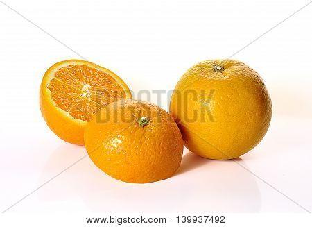 Orange Fruits Close Up On Background