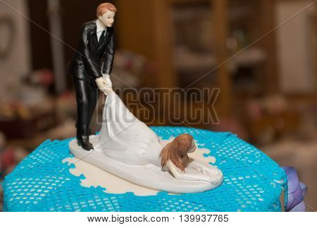 decorative and funny bridal couple on a wedding cake