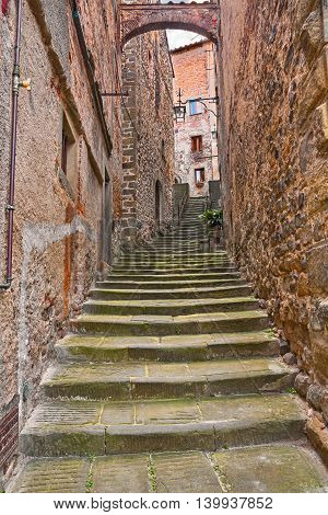 Anghiari, Arezzo, Tuscany, Italy: picturesque ancient narrow alley with staircase and arch in the Tuscan medieval village