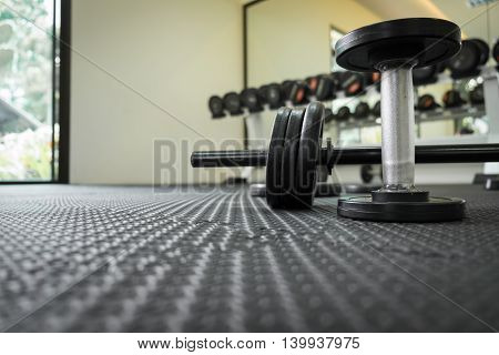 exercise weights - iron dumbbell with extra plates.