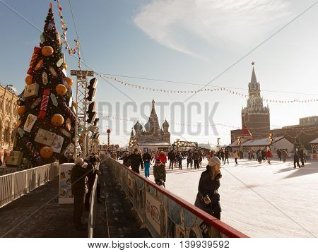 Moscow - November 29 2015: New Year on Red Square skating rink Christmas tree in retro style and people ice-skating near the Kremlin November 29 2015 Moscow Russia