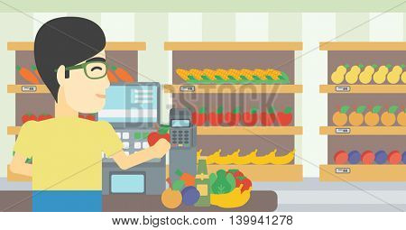 An asian young male cashier standing at the checkout in supermarket. Male cashier working at checkout in supermarket. Vector flat design illustration. Horizontal layout.