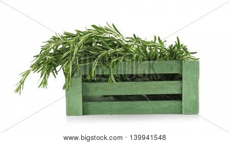 Fresh rosemary in wooden box, isolated on white