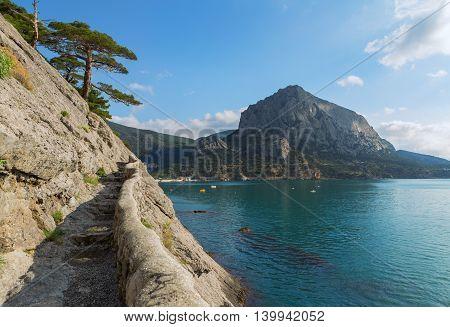 Trail Golitsyn - Falcon Path a mountain pathway carved on the side of Koba-Kaya. Crimea