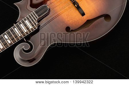 Mandolin isolated on black background, front detail