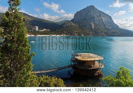 Wooden pier and Mount Falcon near village Novyi Svit in the Crimea.