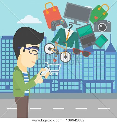 An asian young man holding a smartphone with shopping cart and application icons flying out on a city background. Vector flat design illustration. Square layout.