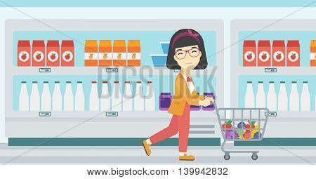 An asian young woman pushing a supermarket cart with some goods in it. Customer shopping at supermarket with cart full with groceries. Vector flat design illustration. Horizontal layout.