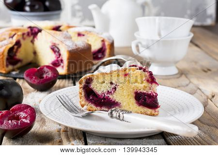 Plum cake on an old wooden table. Rustic style. Selective focus.
