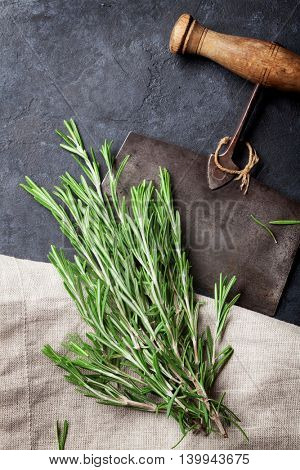 Rosemary bunch. Herbs and spices cooking on stone table. Top view