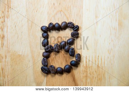 Alphabet 'b' Make From Coffee Bean On Wood Background