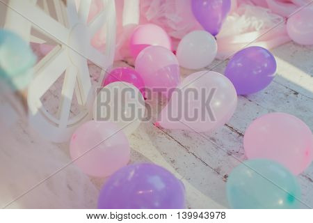 beautiful delicate decoration birthday on the wooden floor of colored balloons
