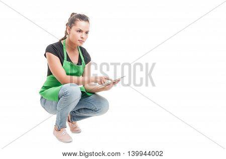 Beautiful Supermarket Saleswoman Checking The Prices