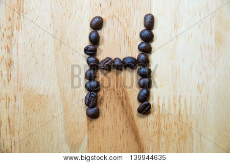 Alphabet 'h' Make From Coffee Bean On Wood Background