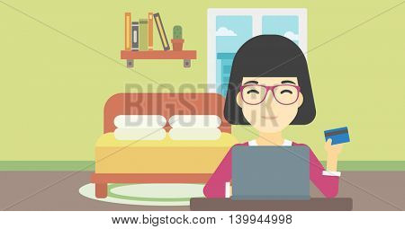 An asian woman holding a credit card and using laptop for online shopping. Woman shopping online at home. Woman making online payment. Vector flat design illustration. Horizontal layout.