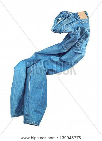 Blank blue jeans are falling through the air on an isolated white background.
