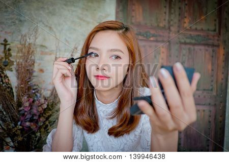 Girl Looking Up The Mascara