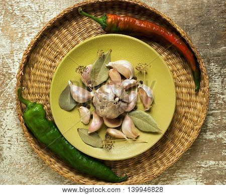 Set of spices and herbs on rustic wooden table and wicker basket