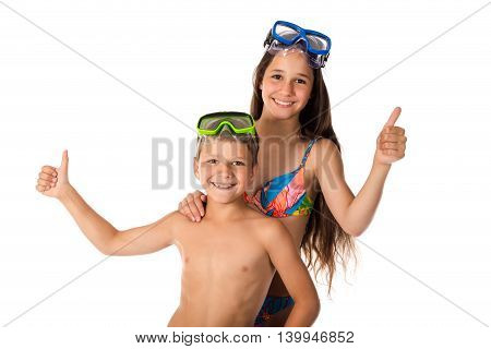 Two happy kids in diving mask standing together, isolated on white