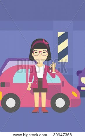 An asian woman holding keys to her new car. Happy young woman showing key to her new car on the background of car shop. Woman buying car. Vector flat design illustration. Vertical layout.
