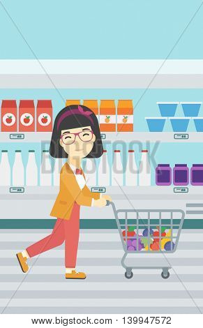 An asian young woman pushing a supermarket cart with some goods in it. Customer shopping at supermarket with cart full with groceries. Vector flat design illustration. Vertical layout.