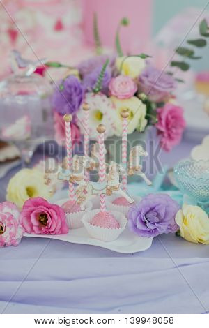 Children's birthday decorations on the holiday table, flowers and beautiful desserts