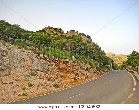 road / curve in the mountains - blue sky