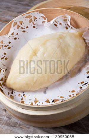 One dim sum in bamboo steamer box
