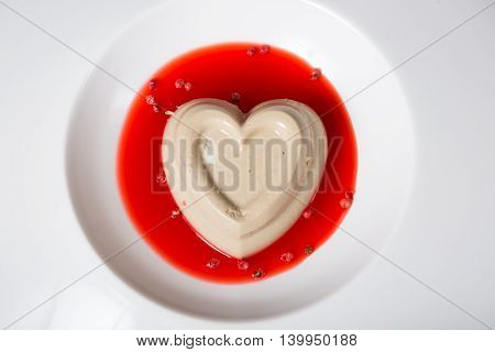 Heart shaped pate served with cranberry sauce