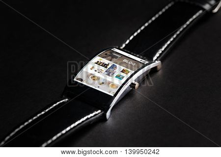 modern technology, internet, object and media concept - close up of black smart watch with blog web page on screen