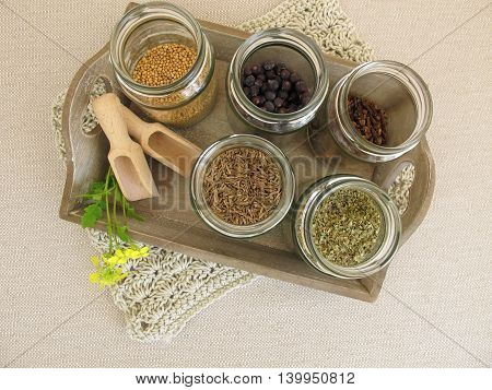 Dried herbs and spices in jars for cooking