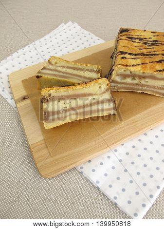 Homemade layer zebra cake on baking paper