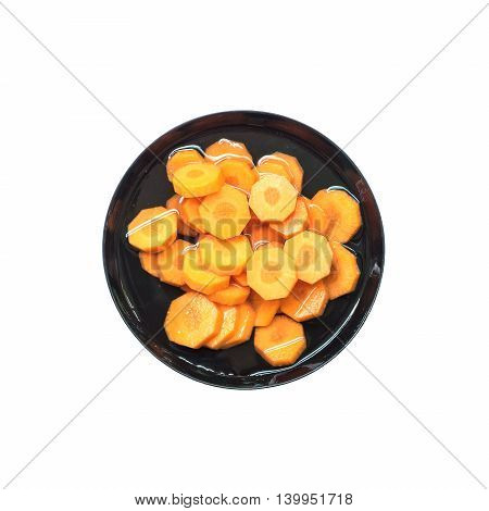 Closeup fresh pile of carrot in water on black plastic bowl isolated on white background prepare for cook concept