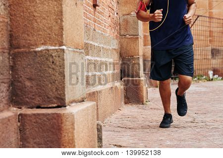 Cropped image of man jogging in the morning