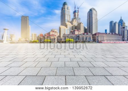 Empty brick floor with city skyline and cityscape background