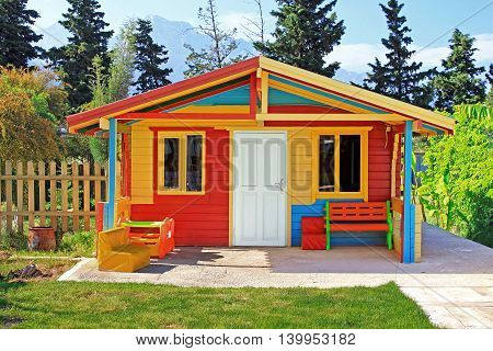 Children's play house in a yard in the summer
