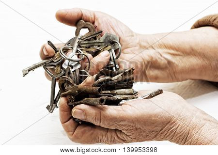 Bunch of old keys in old female hands
