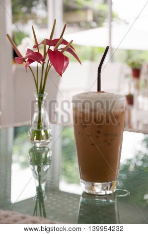 Ice coffee with red flower. Ice Latte with beautiful red flower.