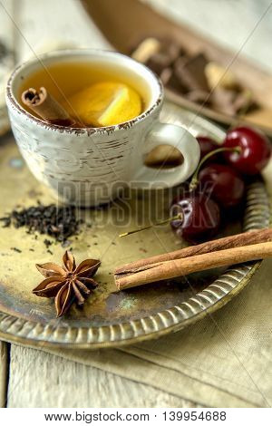 Cherries, tea with lemon, cinnamon and anise