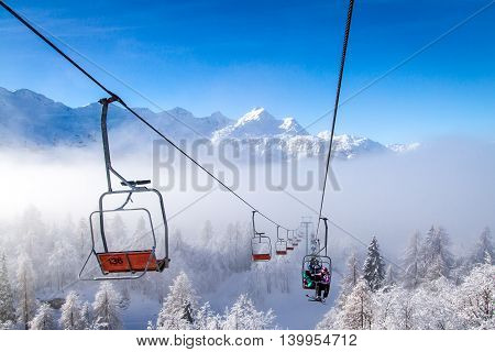 Winter mountains panorama with ski slopes and ski lifts at Vogel ski center, Slovenia.