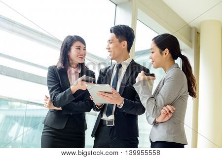 Business team discussing something on tablet computer