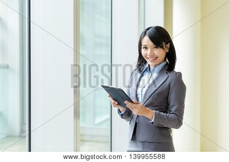 Asian buisness woman use of tablet computer