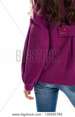 Girl wears purple coat. Light blue denim pants. Top quality material for outerwear. Short stylish coat.